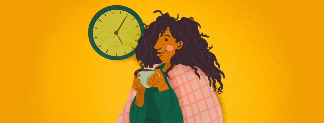 Person cozies up under blankets with coffee and clock behind them