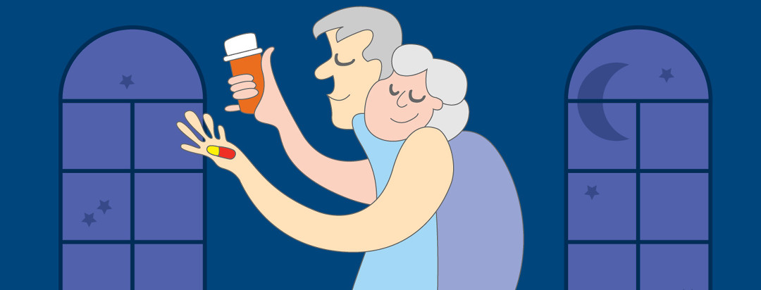 Caregiver helping her husband take the pills he needs in the middle of the night