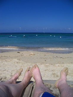 Dan and Wife Heather's feet on a beach in Jamaica