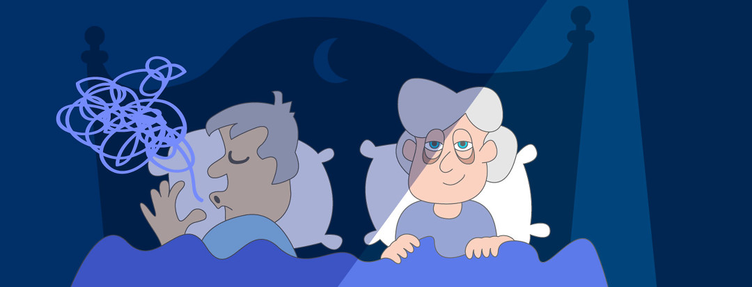 An older couple lies in bed with the man asleep and snoring while the woman lies awake next to him