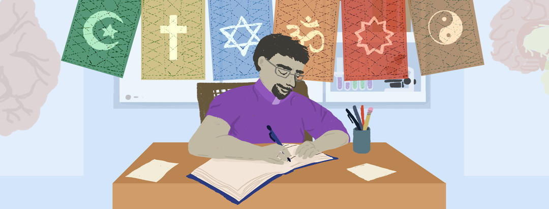 A chaplain writes in a book at his desk in a hospital office. A string of bunting with flags featuring the Muslim, Christian, Jewish, Hindu, Ba'hai, and Tao symbols fly above him.
