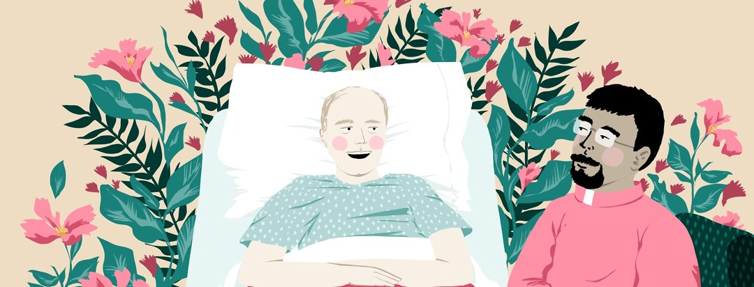 A chaplain sits next a cheery-looking patient in a hospital bed. Behind the pair and the bed, flowers and plants grow as the backdrop to the scene.