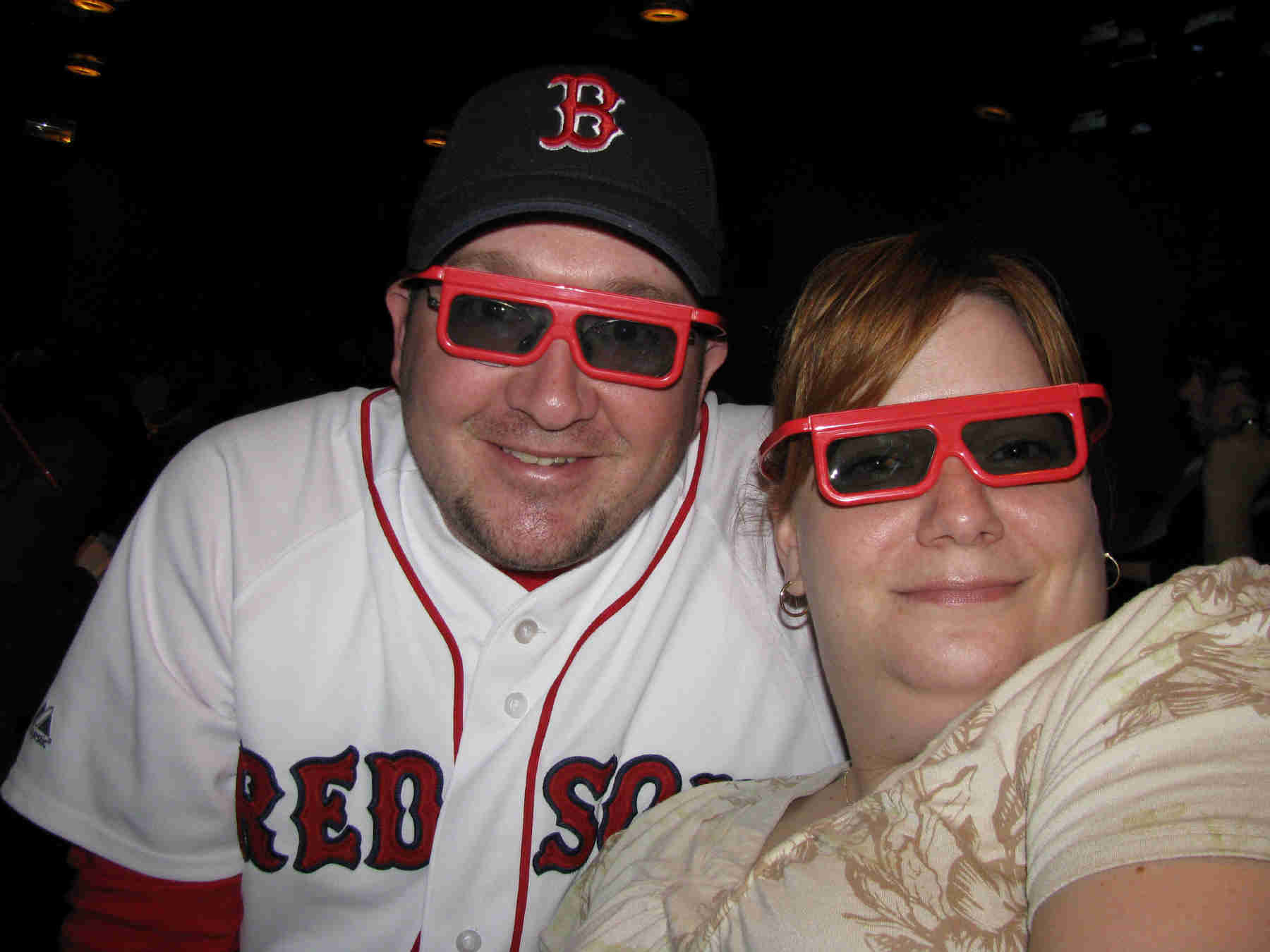 Dan and Wife Heather wearing fun red framed glasses