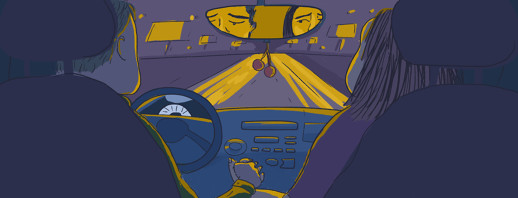 A couple holds hands in the front seats of a car at night. They look at each other worryingly in the rearview mirror.