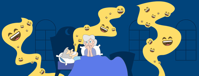A woman watching her husband sleep next to her while smiley face emoji's fill the air around him as he giggles while he's sleeping.