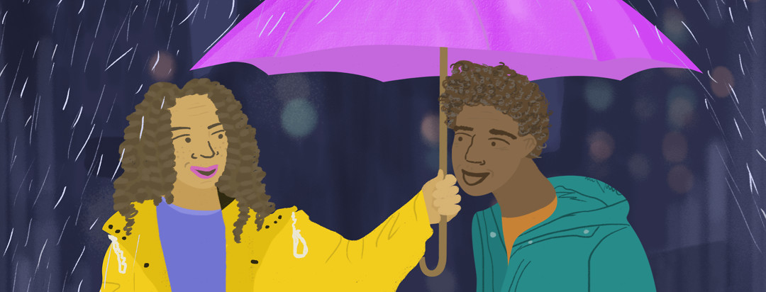 On a rainy city evening, a woman holds out her umbrella to a man who forgot his at home.