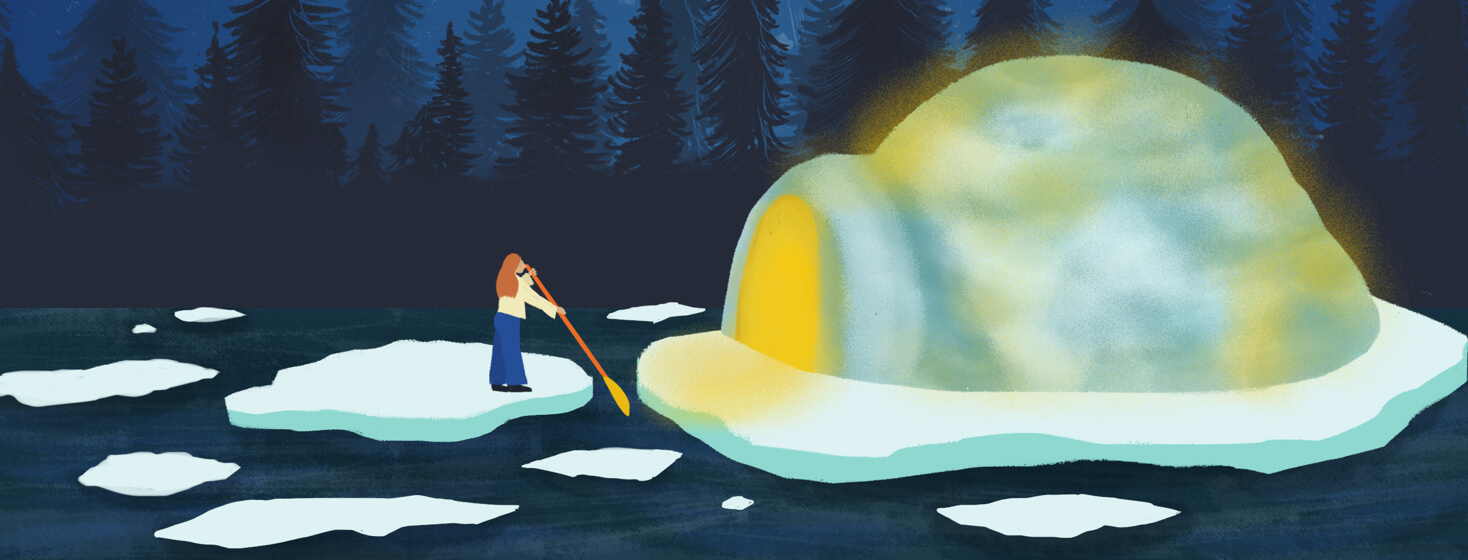 A person with long hair paddles from one piece of ice to a floating glacier with a lit up igloo.