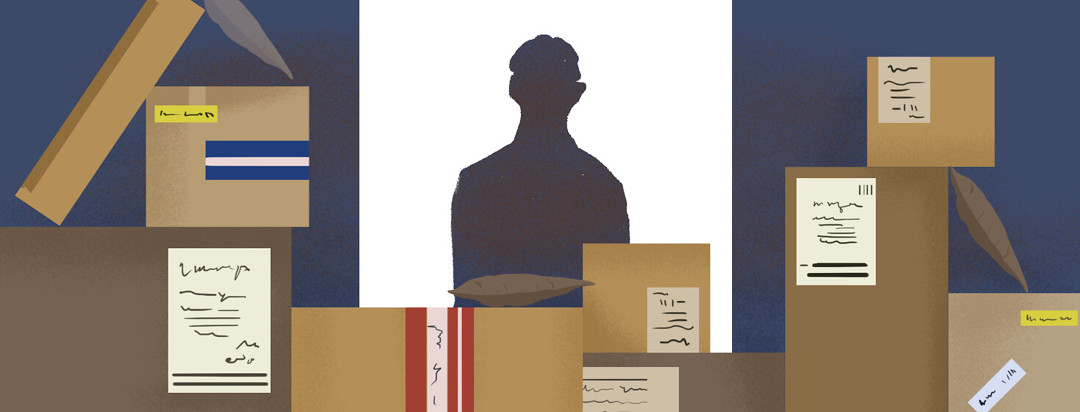 Silhouette of man in doorway visible behind large piles of boxes and packages.
