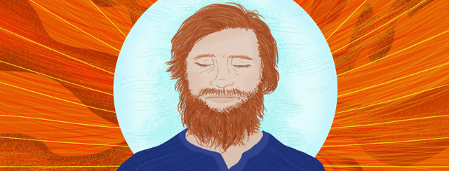 Man with long beard closes eyes to meditate in blue bubble with fire swirls surrounding him.