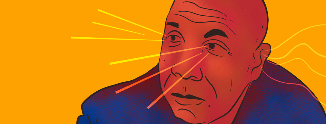 Bald man stares off as beams of sound and light spring from to his ear and from his eyes.