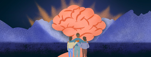 Family holds each other while looking at mountains and brain looming over sky
