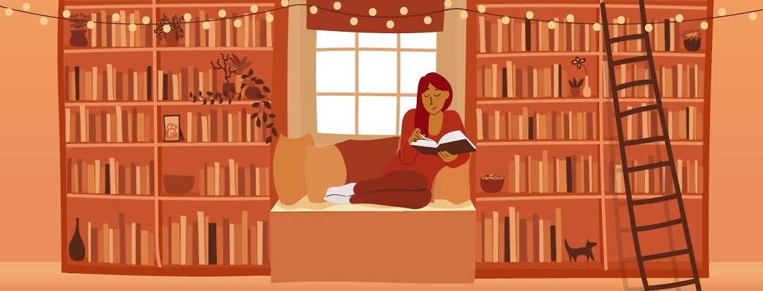 Woman reading a book in a cozy window seat.