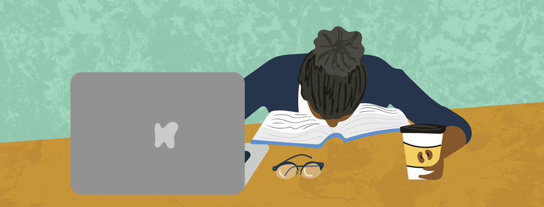Woman with gray bun falls asleep in open book with hand on coffee cup; laptop open and glasses on table