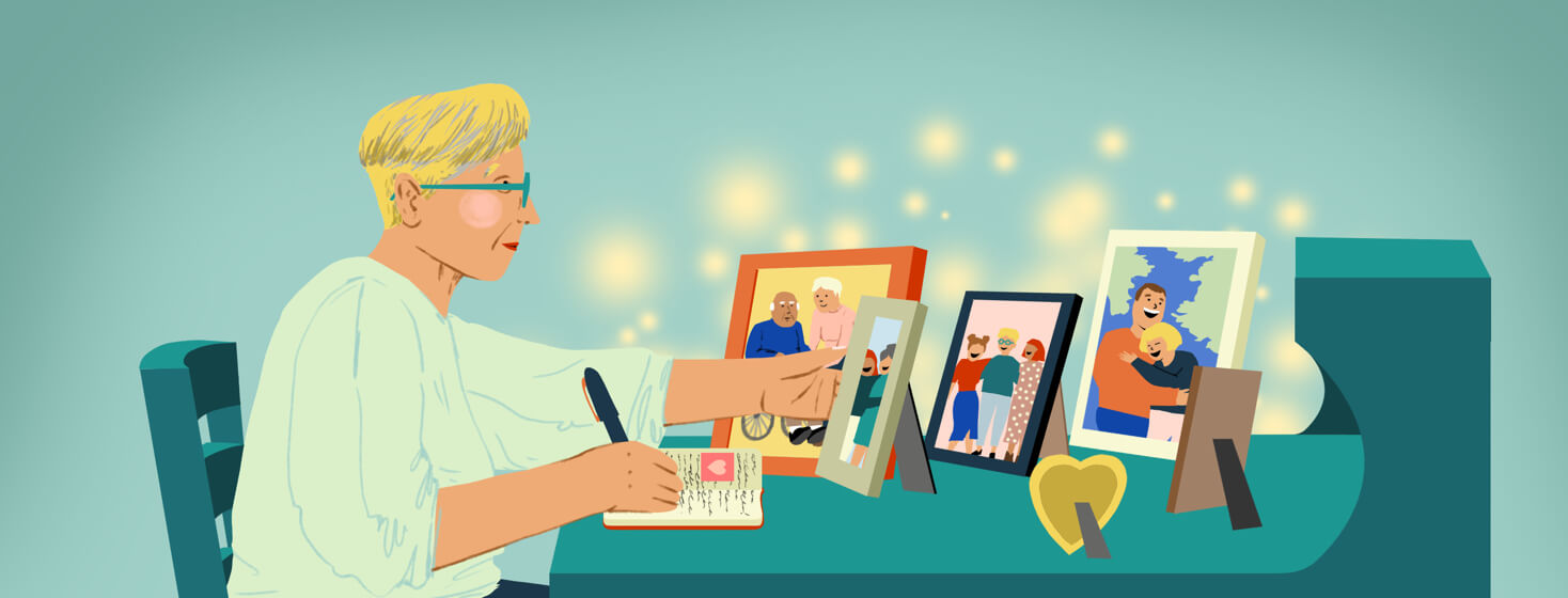 Blonde short haired woman writes letters in notebook while looking at family photos