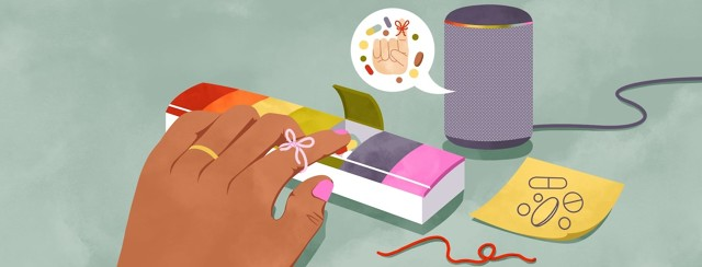 A hand with a string tied to the index finger reaches into a pill organizer for the tablets inside. Beside the organizer is an untied piece of string, a post-it note with pills drawn on it, and and Alexa device providing a reminder to take pills.