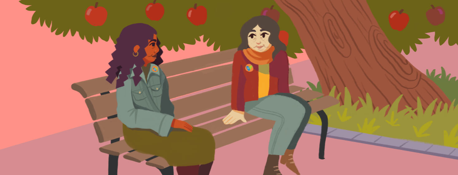 Two older adult females talking to each other on a park bench in front of an apple tree.