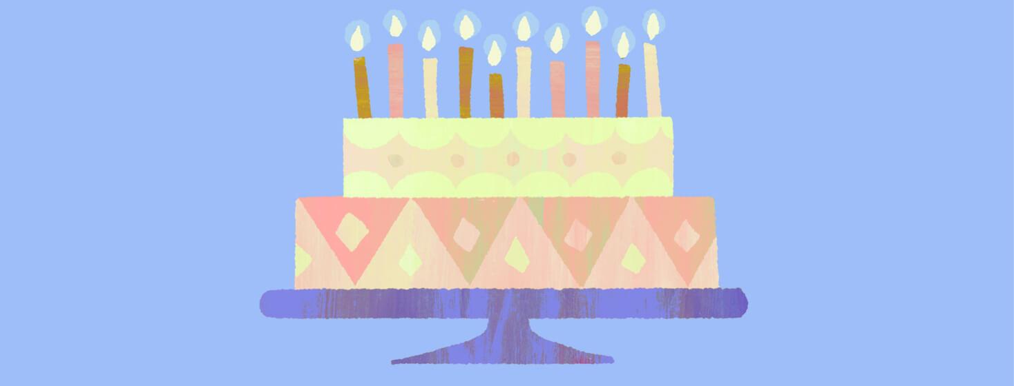 Birthday cake sitting atop a cake stand