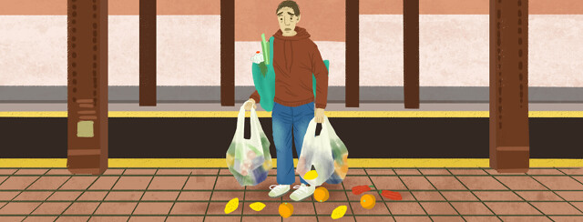 Man on subway platform looks in horror as his bags of groceries split all over the floor